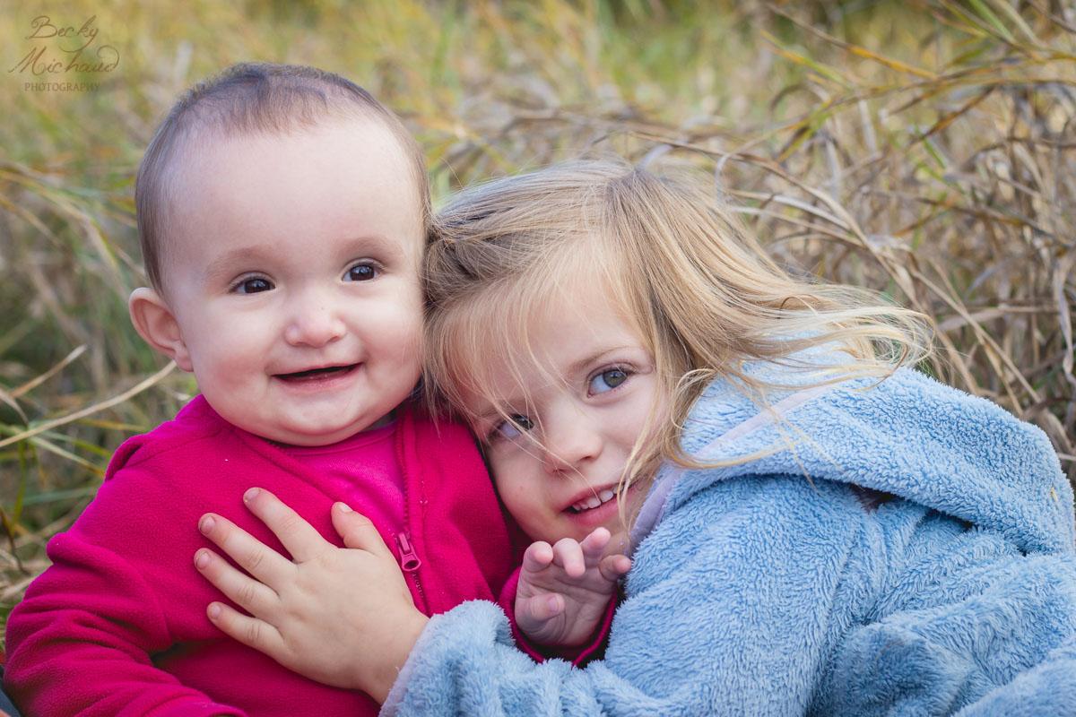 Portrait of sisters in a field in Colorado