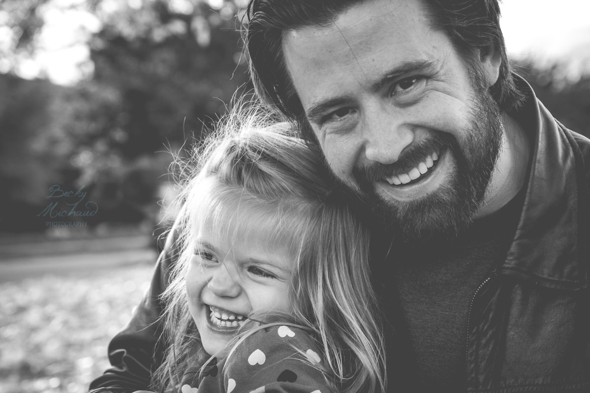 black and white photo of a young girl with her dad