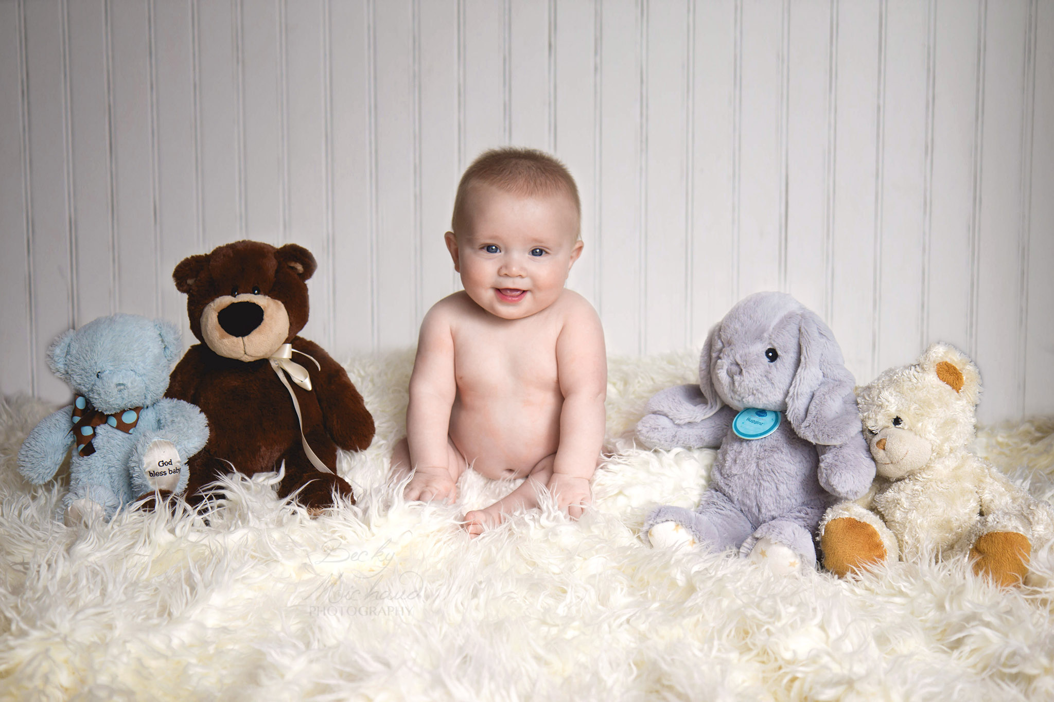 Infant with stuffed animals