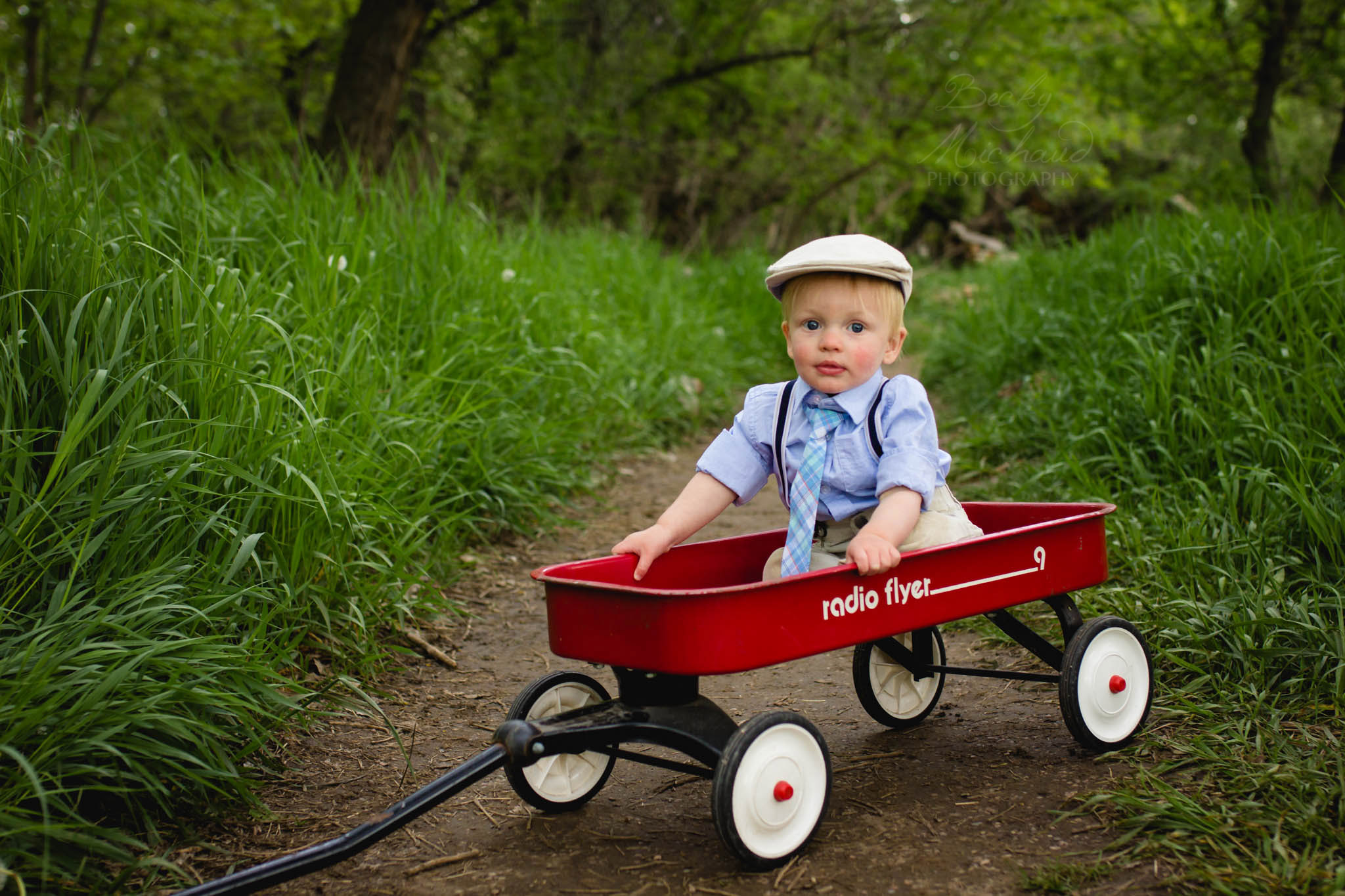 Baby boy in a red wagon