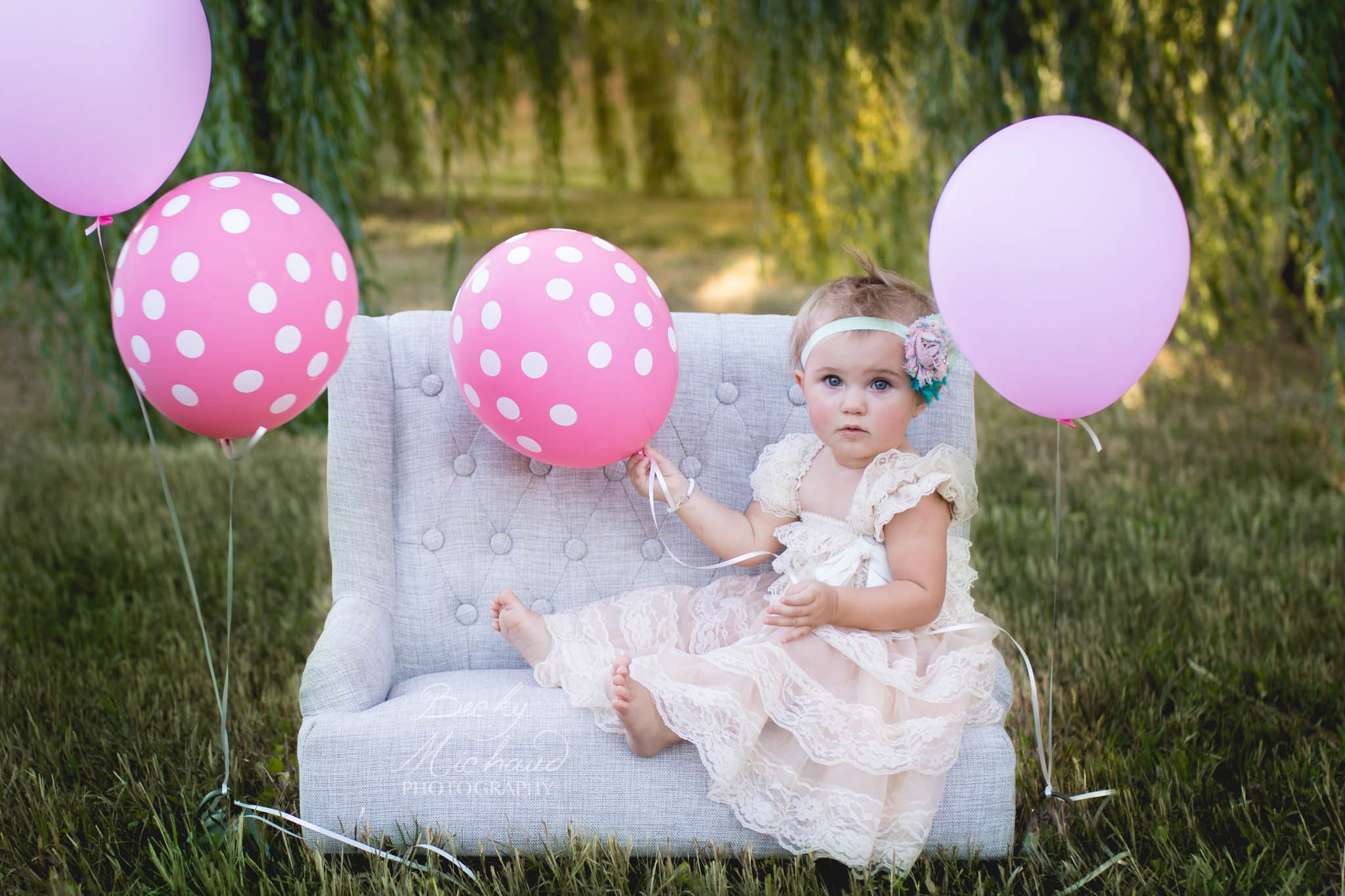 One year old girl with pink balloons in Fort Collins Colorado