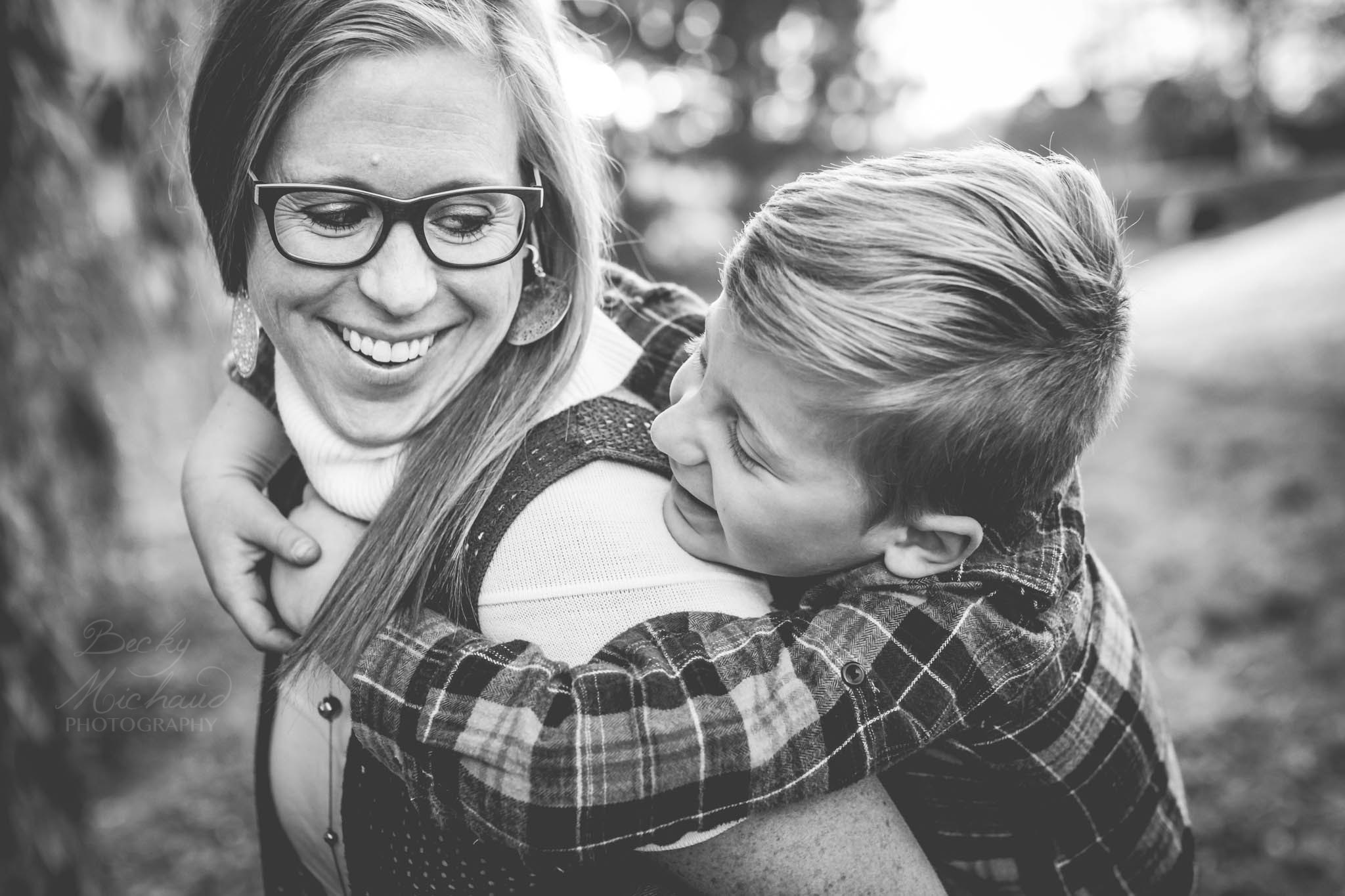 Mother and son playing with each other and having fun during a family photo session