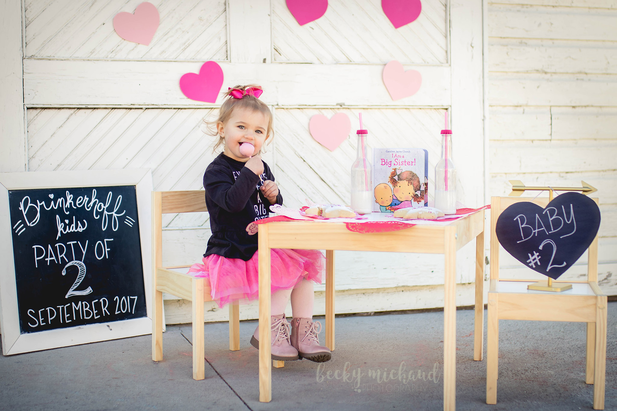 A valentine's day themed photo shoot at Jessup Farm in Fort Collins to announce a new baby sibling