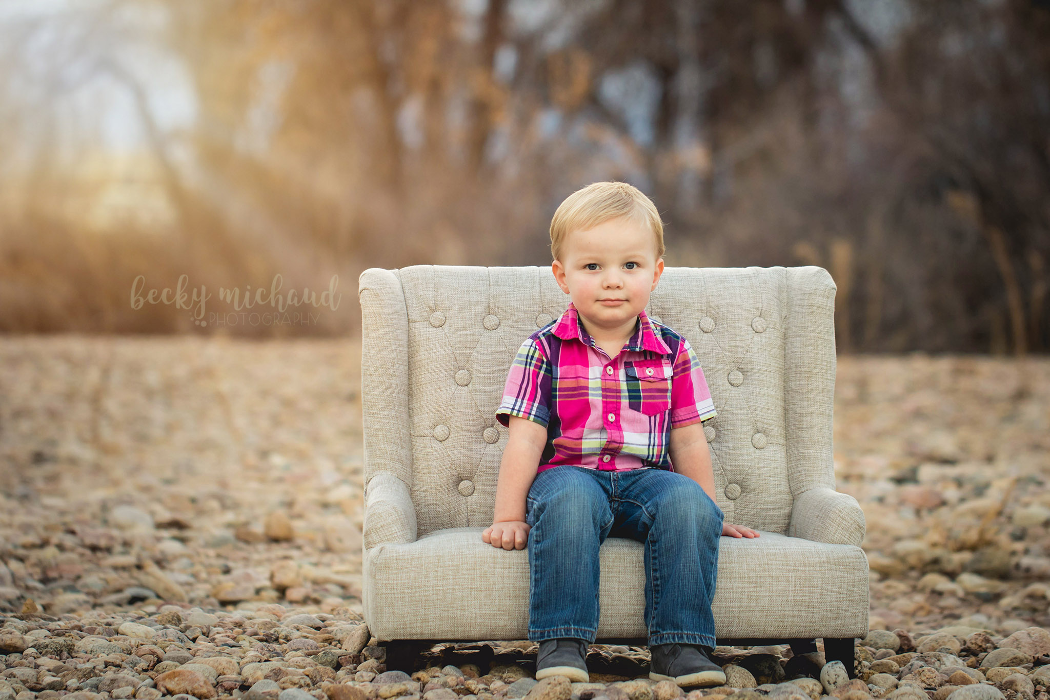 Becky Michaud, Northern Colorado photographer, takes a photo of a little boy on a couch