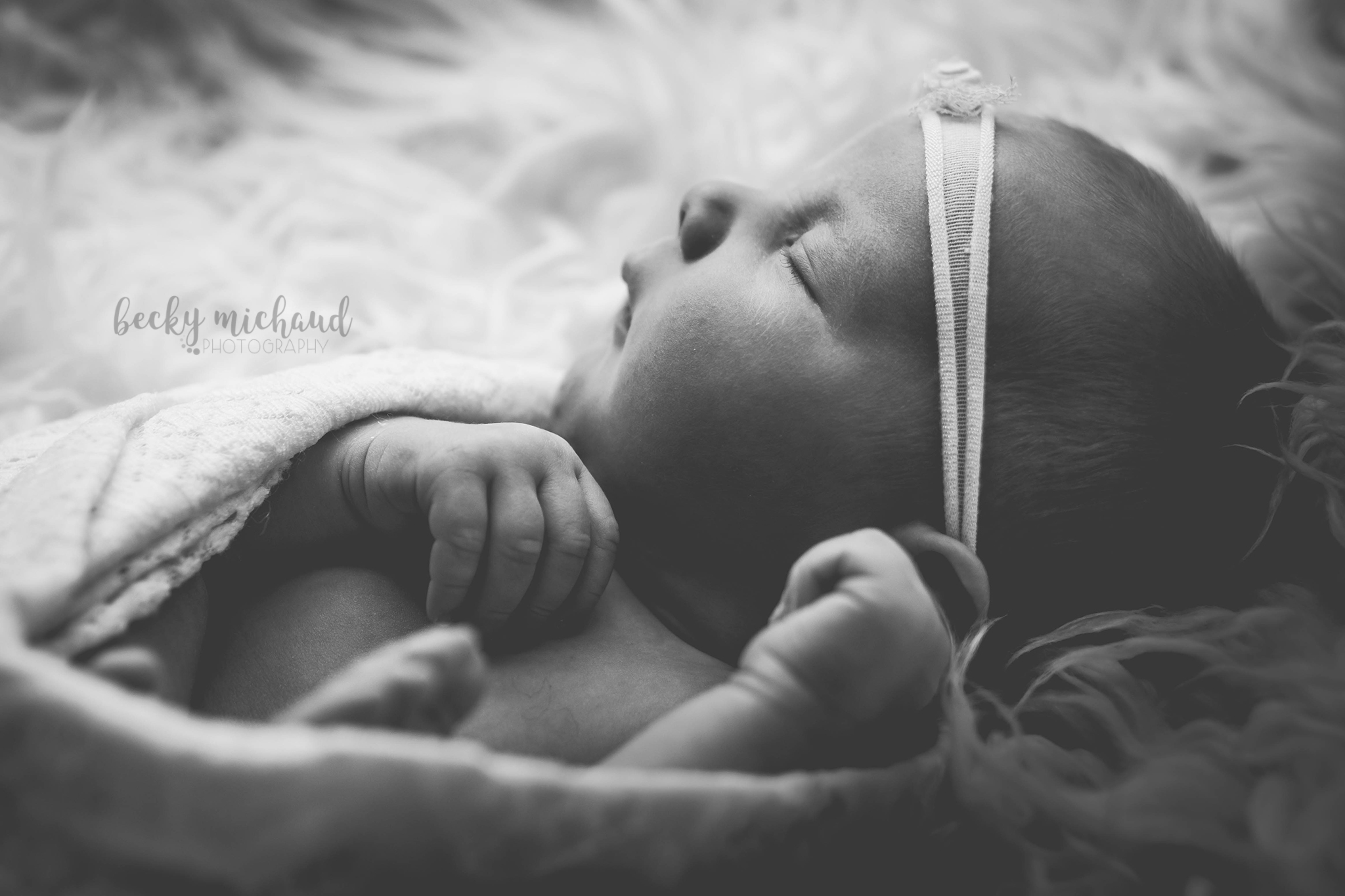black and white profile of a newborn baby girl