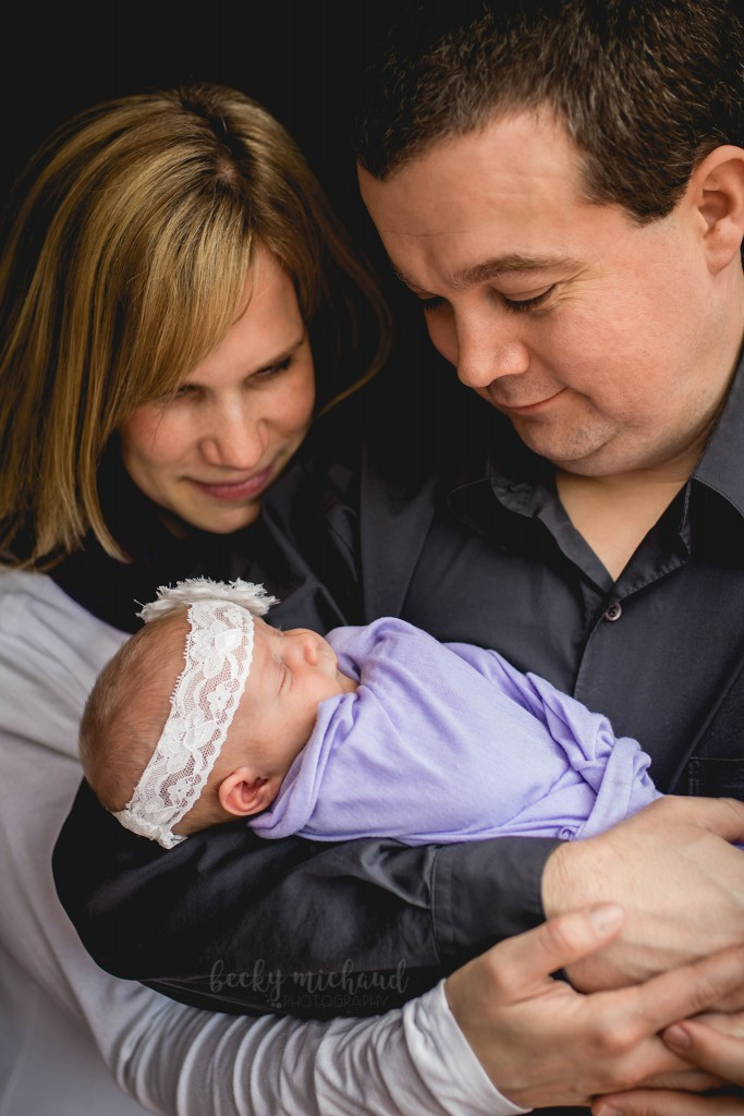 Fort Collins parents with their newborn baby girl