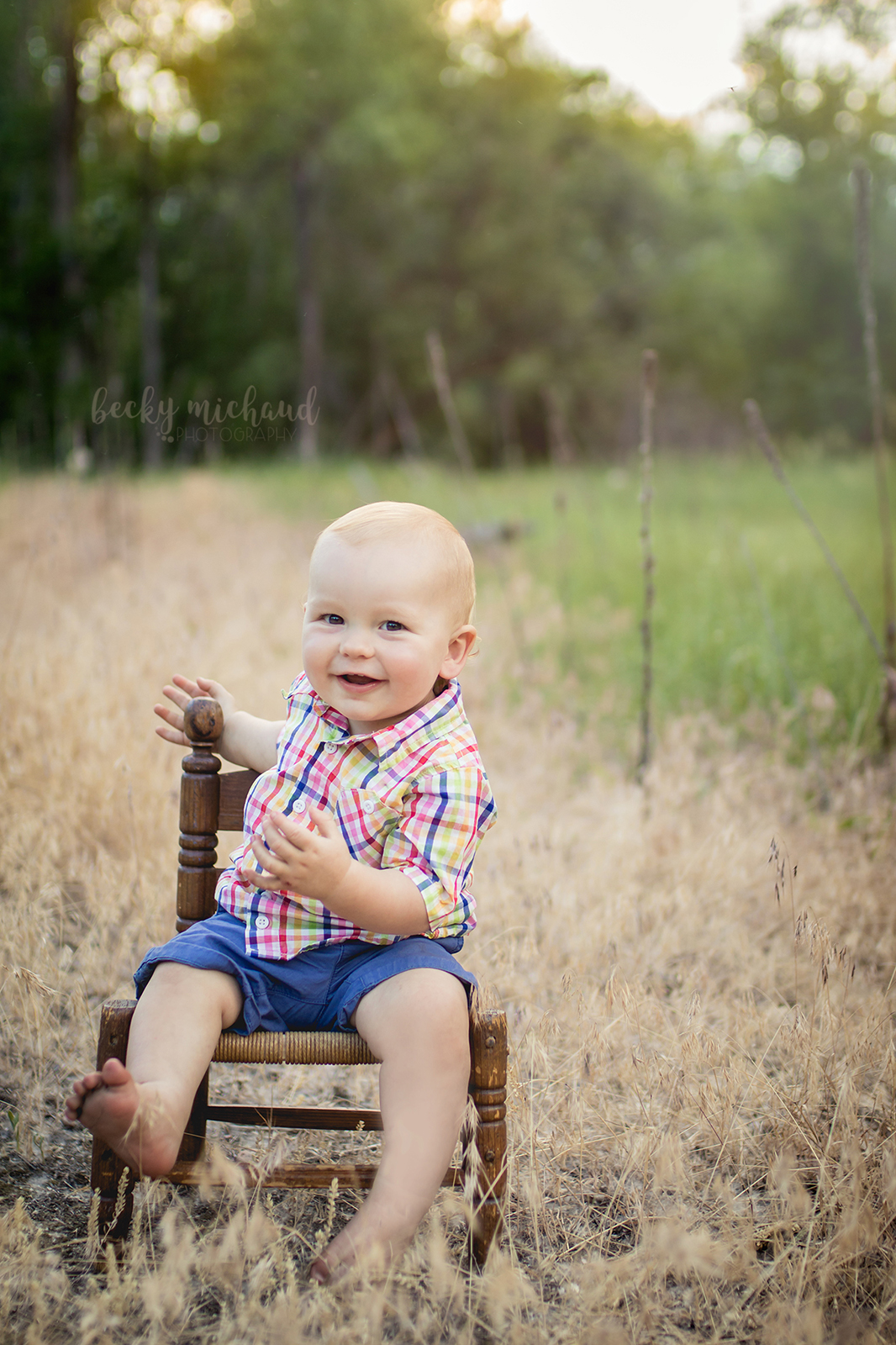 one year old boy sitting in a little chair in a field in north Fort Collins