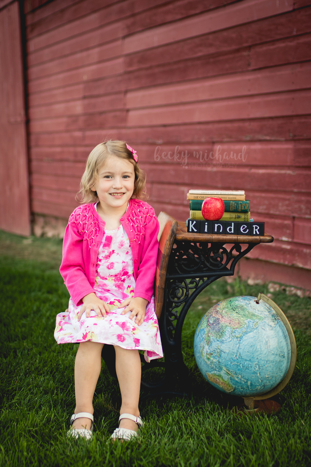 Back to school mini session photo with an antique desk and globe