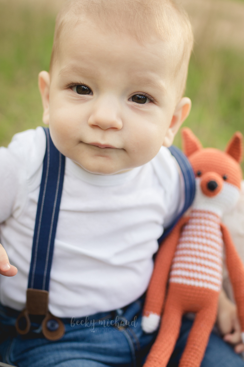 close up of baby boy with stuffed fox taken by Becky Michaud, Northern Colorado photographer
