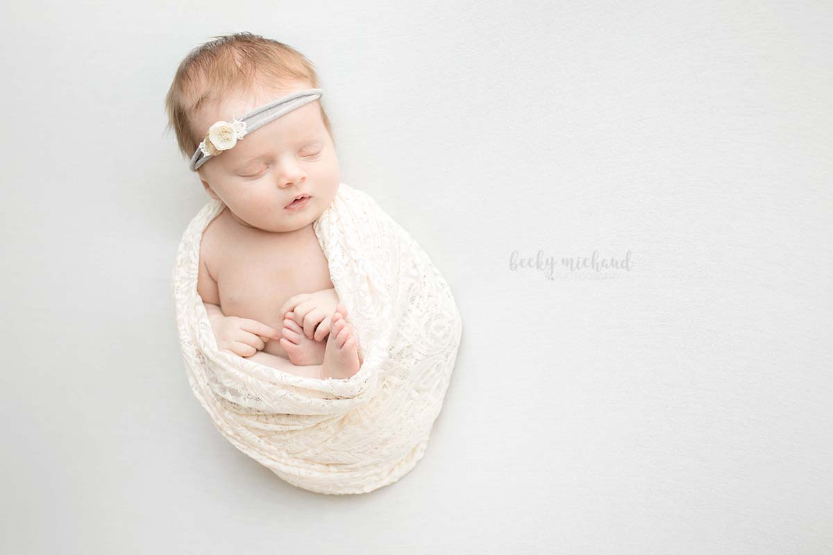 simple newborn photo session of a baby girl in Milliken, Colorado