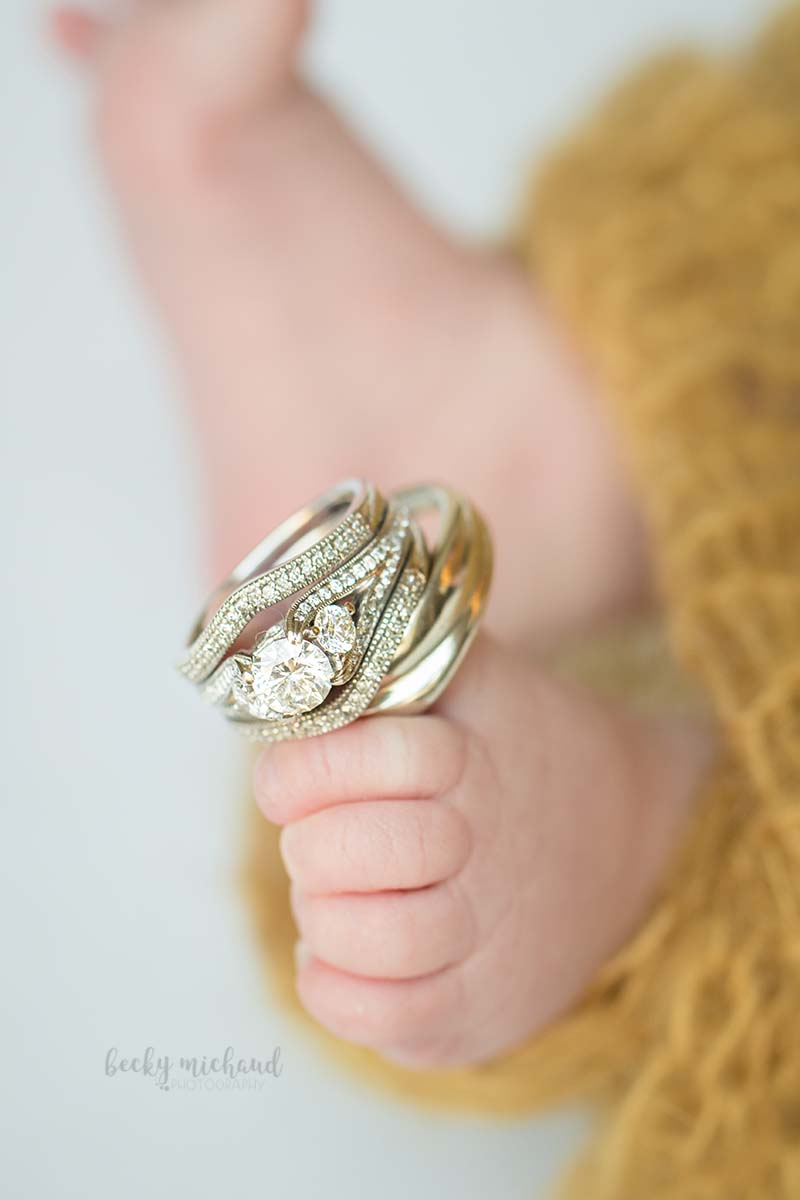 wedding rings on a newborn baby's toes