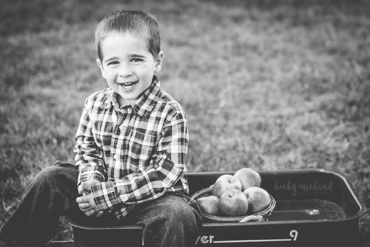 Black and white photo of a boy laughing during his Fort Collins back to school photo session