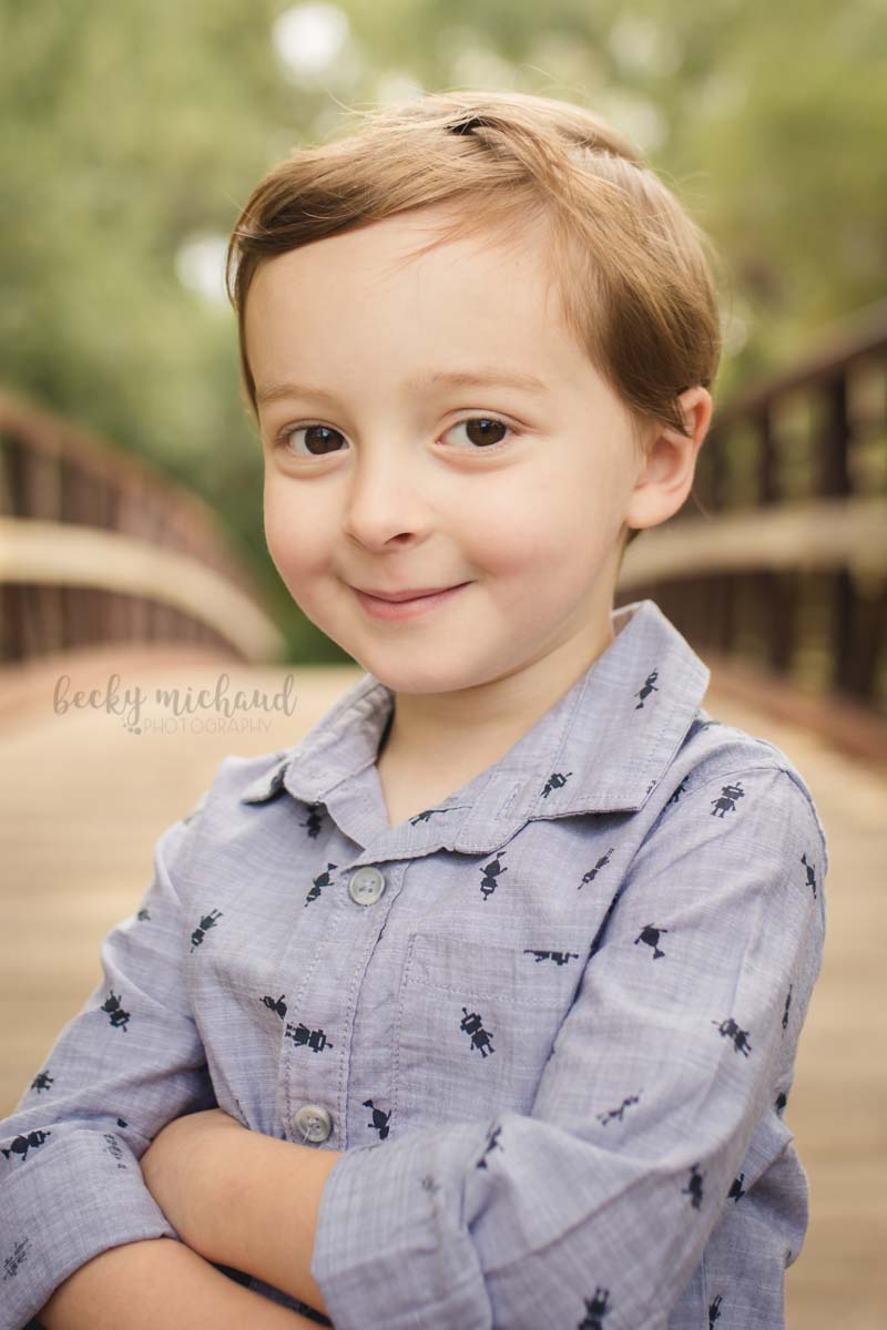 Boy posing on a bridge in north Fort Collins for Becky Michaud, family photographer