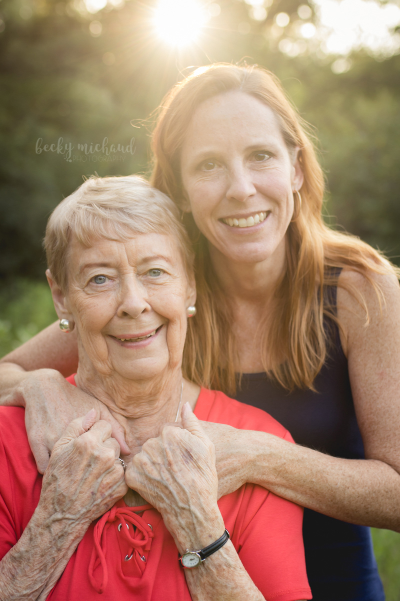 A mother and grown daughter pose for a portrait in Fort Collins