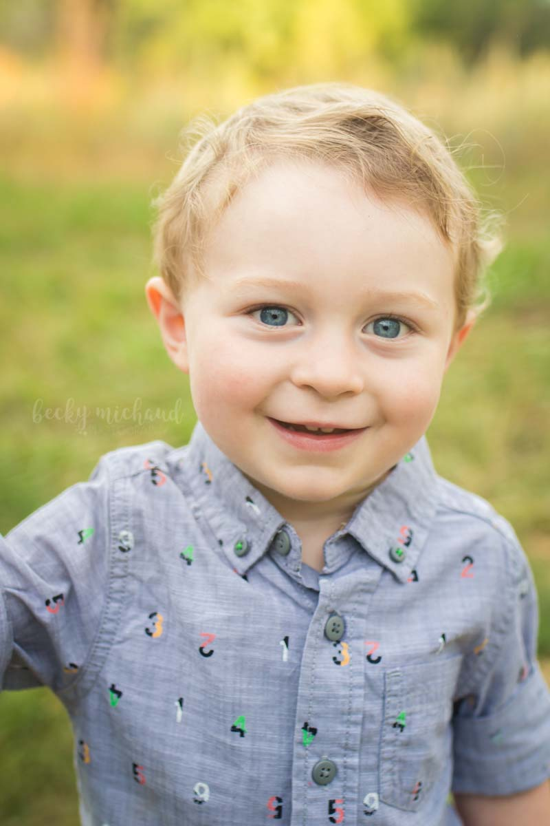 Portrait of a two year old boy playing in a field in Fort Collins, Colorado