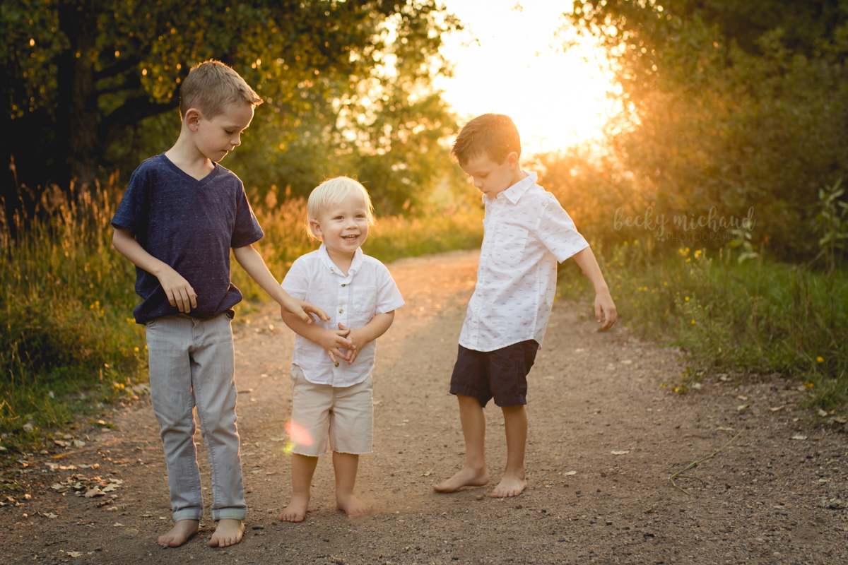Brothers play together in the golden light of the Colorado sunset