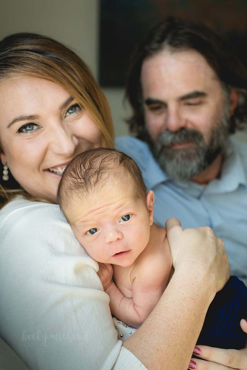 Family photo taken during a newborn photo session in Fort Collins Colorado