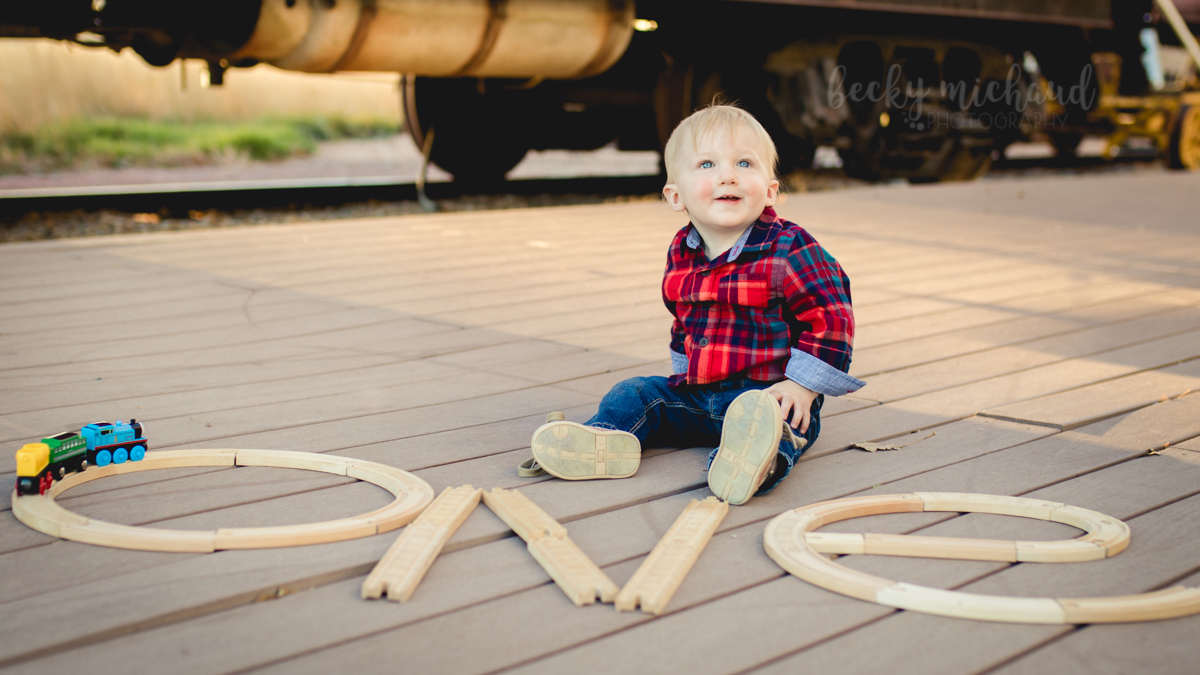 Train themed photo for a one year old birthday taken in Windsor Colorado