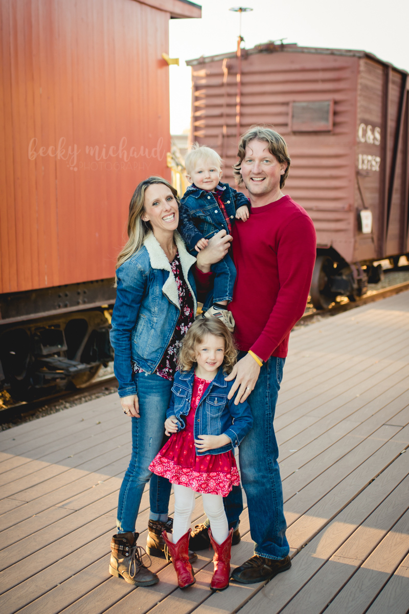 A family of four poses for a photo in Colorado for Becky Michaud, Windsor photographer