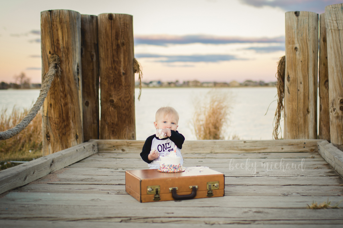 One year cake smash session with the lake and sunset in the background