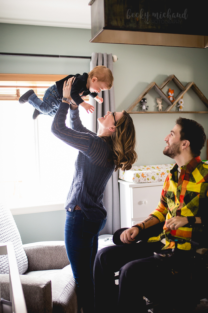 Lifestyle photo of a mom and dad playing with their one year old son in their Fort Collins home