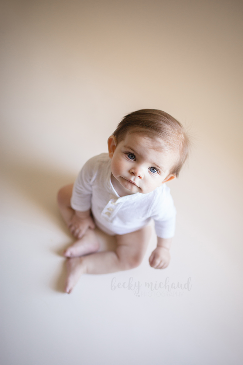 Simple timeless portrait of a six month old baby boy taken in Timnath, Colorado