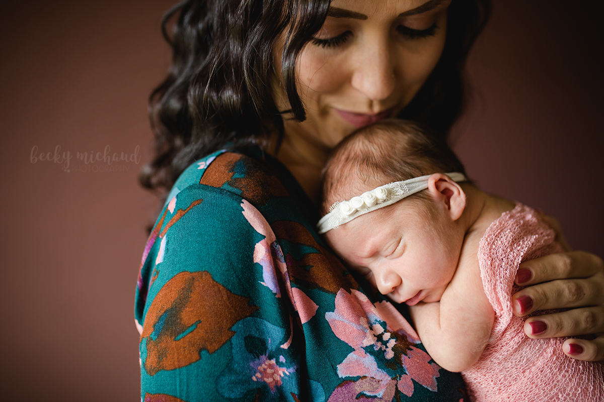 A new mom snuggles with her baby girl in Johnstown, Colorado