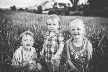Black and white photo of three kids in a field taken by Becky Michaud, Fort Collins Photographer