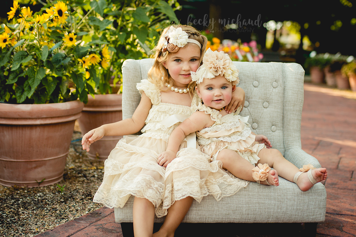 Portrait of two sisters on a couch at the CSU Trial Gardens taken by Becky Michaud, Fort Collins photographer