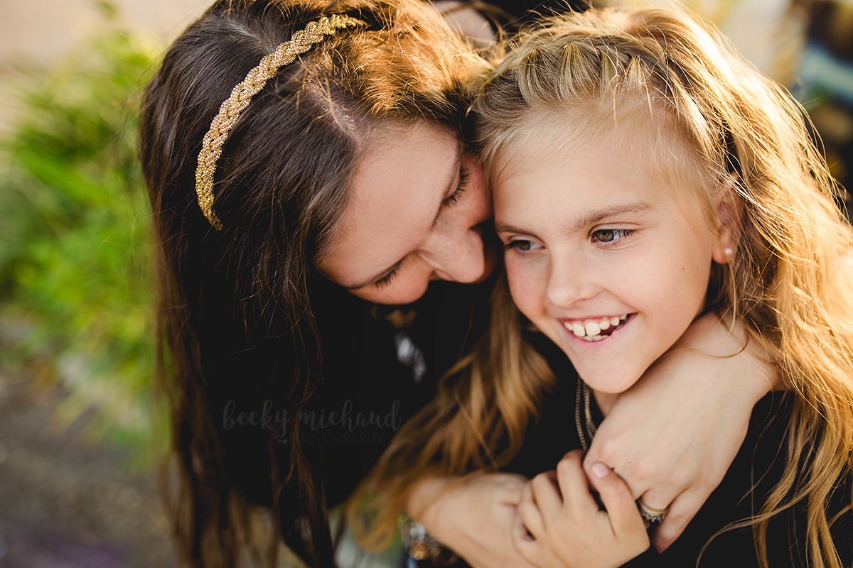 A mom snuggles in close with her daughter on a sunny evening in Northern Colorado