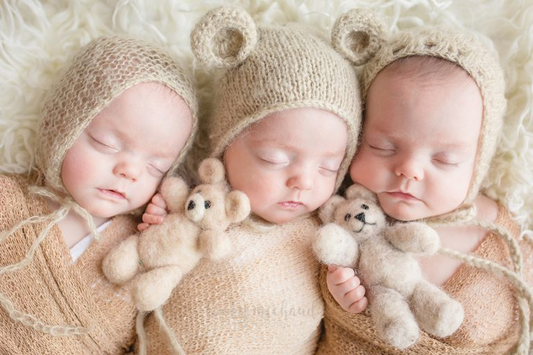 three baby girls snuggle with bears during their Fort Collins newborn photo session