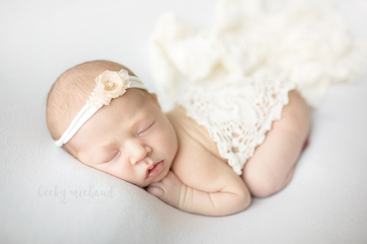 Simple newborn photo in cream colored lace taken by Becky Michaud, Fort Collins newborn photogra]