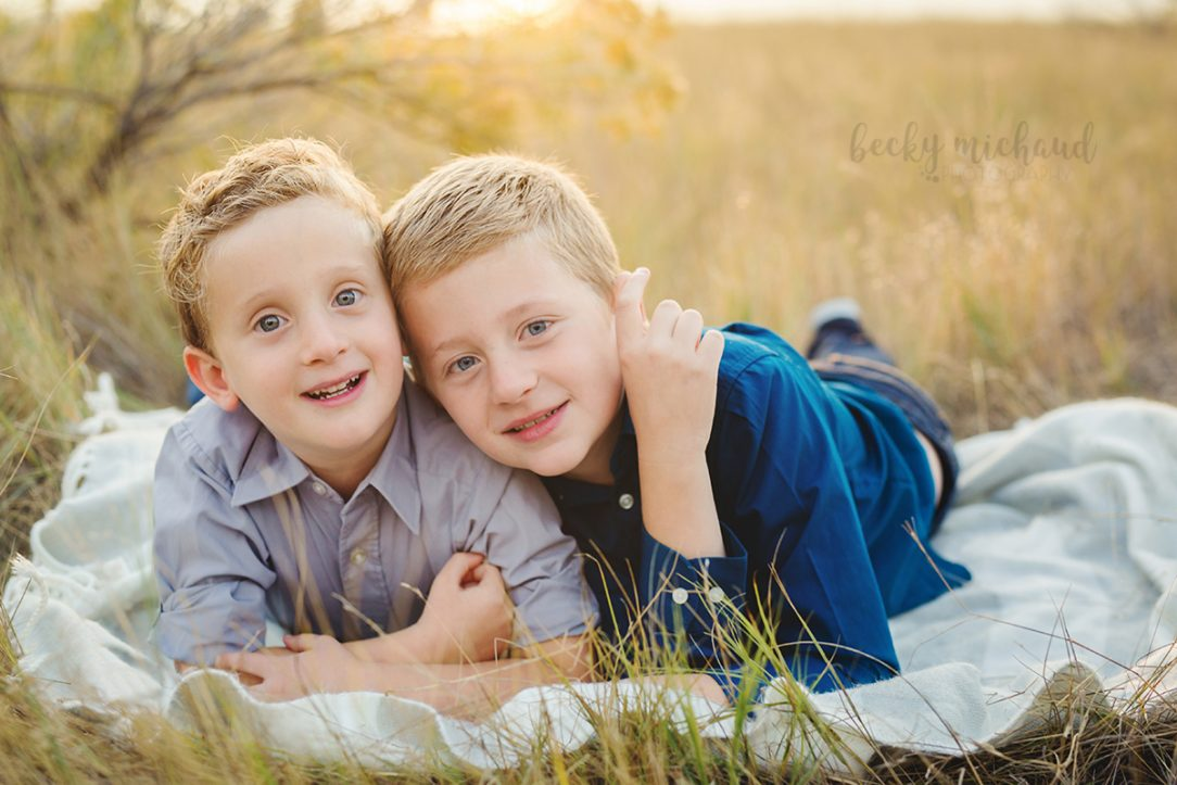 Two brothers share a quiet moment during their Loveland family photo session