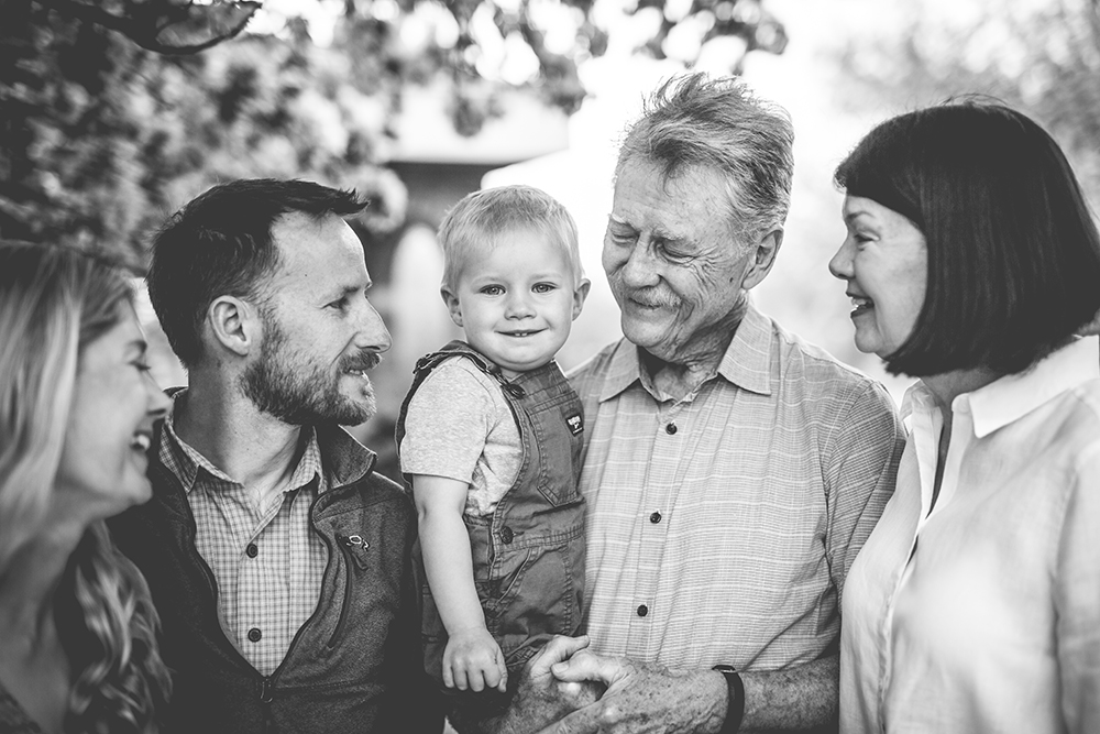 Black and white portrait of three generations of family at a park in Loveland, Colorado
