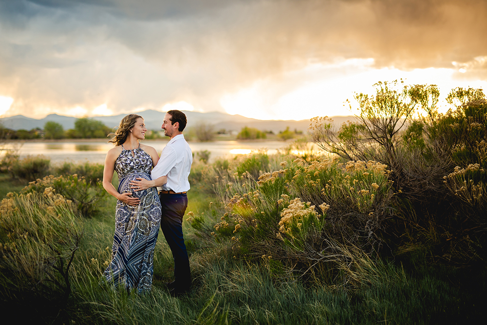 Beautiful sunset over the Colorado mountains near Fort Collins as a part of a maternity photo session