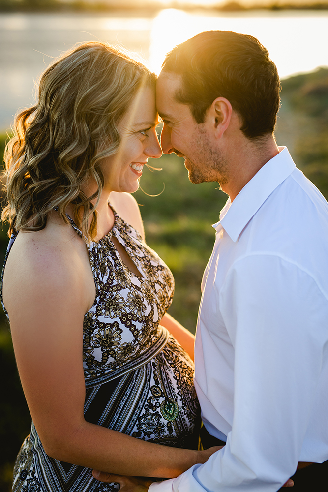 A couple smile together in a maternity photo taken by Becky Michaud, Fort Collins photographer