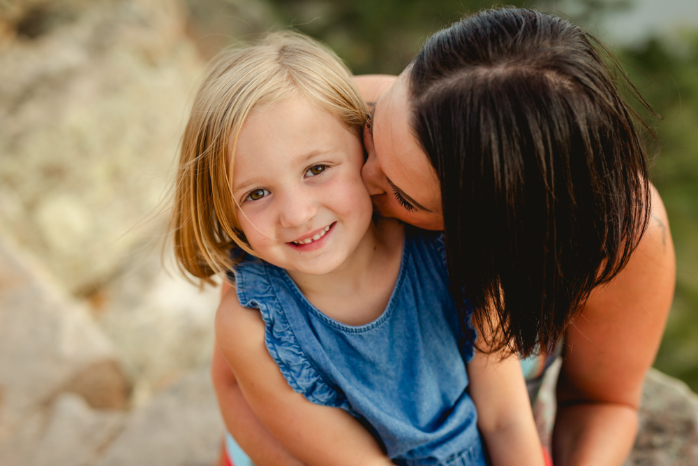 Mom kisses her daughter as they pose for a photo taken by Becky Michaud, Fort Collins photographer