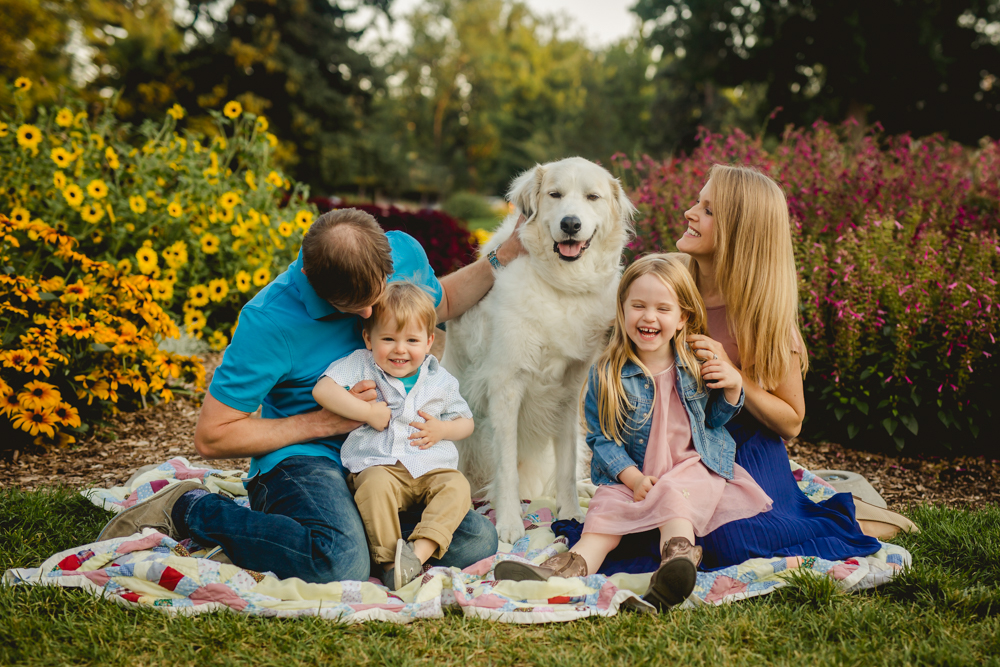 A family poses with their dog at the CSU Trial Gardens in Fort Collins