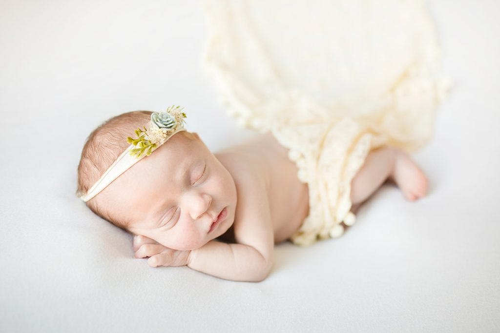 newborn girl in neutral colors in an in home session in Loveland Colorado