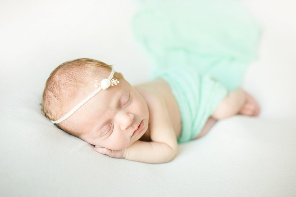 Becky Michaud Photography takes posed newborn photos like this in baby's home in Northern Colorado