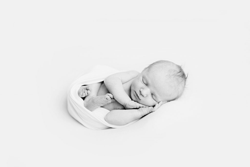 Simple, minimalist, black and white newborn photo taken in baby's home in Northern Colorado