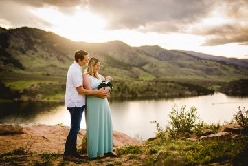 New parents hold their baby at Horsetooth Reservoir in Fort Collins, Colorado