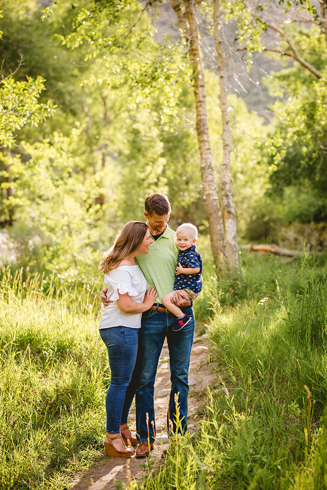 Portrait of a family of three in the woods in Northern Colorado