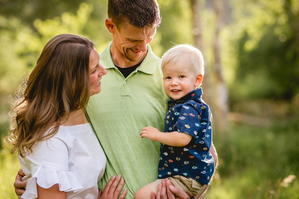 A family of three poses for a photo taken by Becky Michaud, Fort Collins family photographer