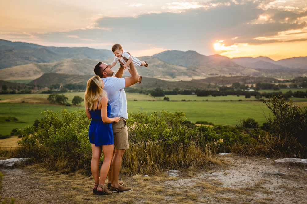 family photo taken in northern Colorado with the sun setting over the mountains