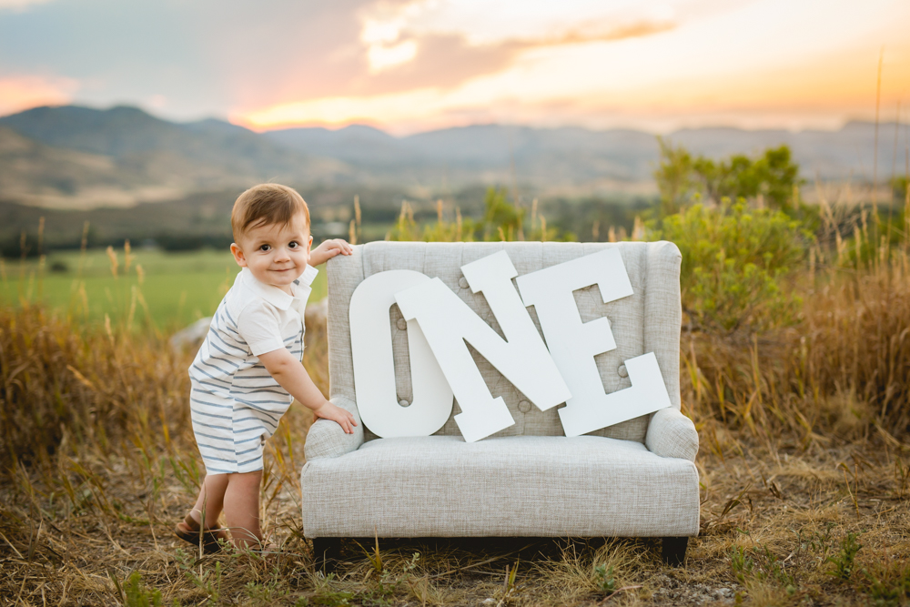 A one year old boy poses for his photo session with Becky Michaud, Fort Collins photographer