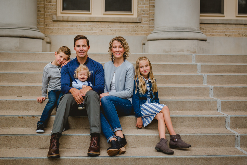 Family of five photo on the steps of a building on CSU campus in Fort Collins, Colorado