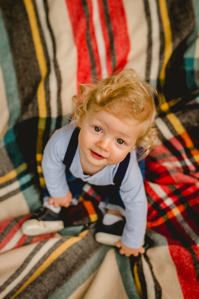 Photo of a baby on a plaid blanket taken by Becky Michaud, Fort Collins photographer