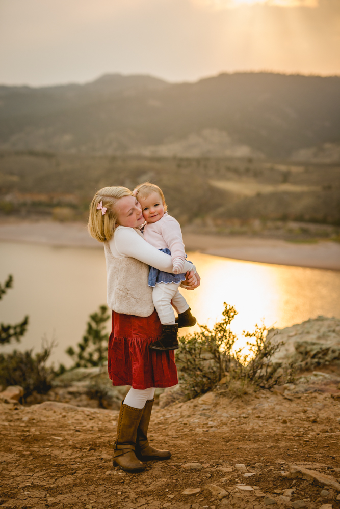 Sisters snuggle together in a photo taken by Becky Michaud, Fort Collins photographer