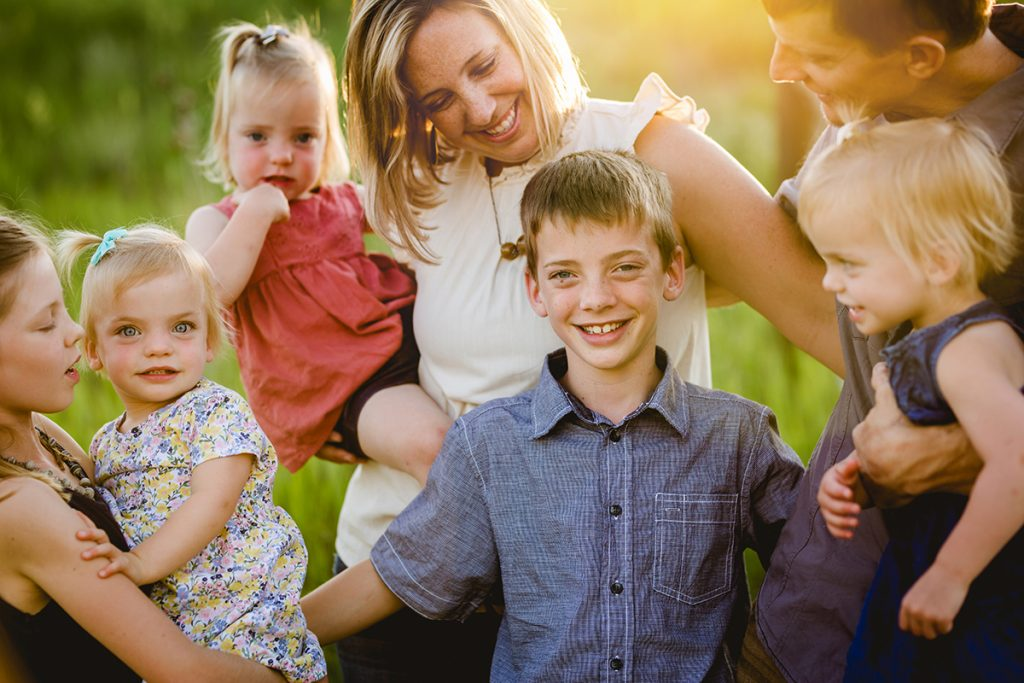 Candid photo of a family in the golden sunlight at a natural area in Fort Collins